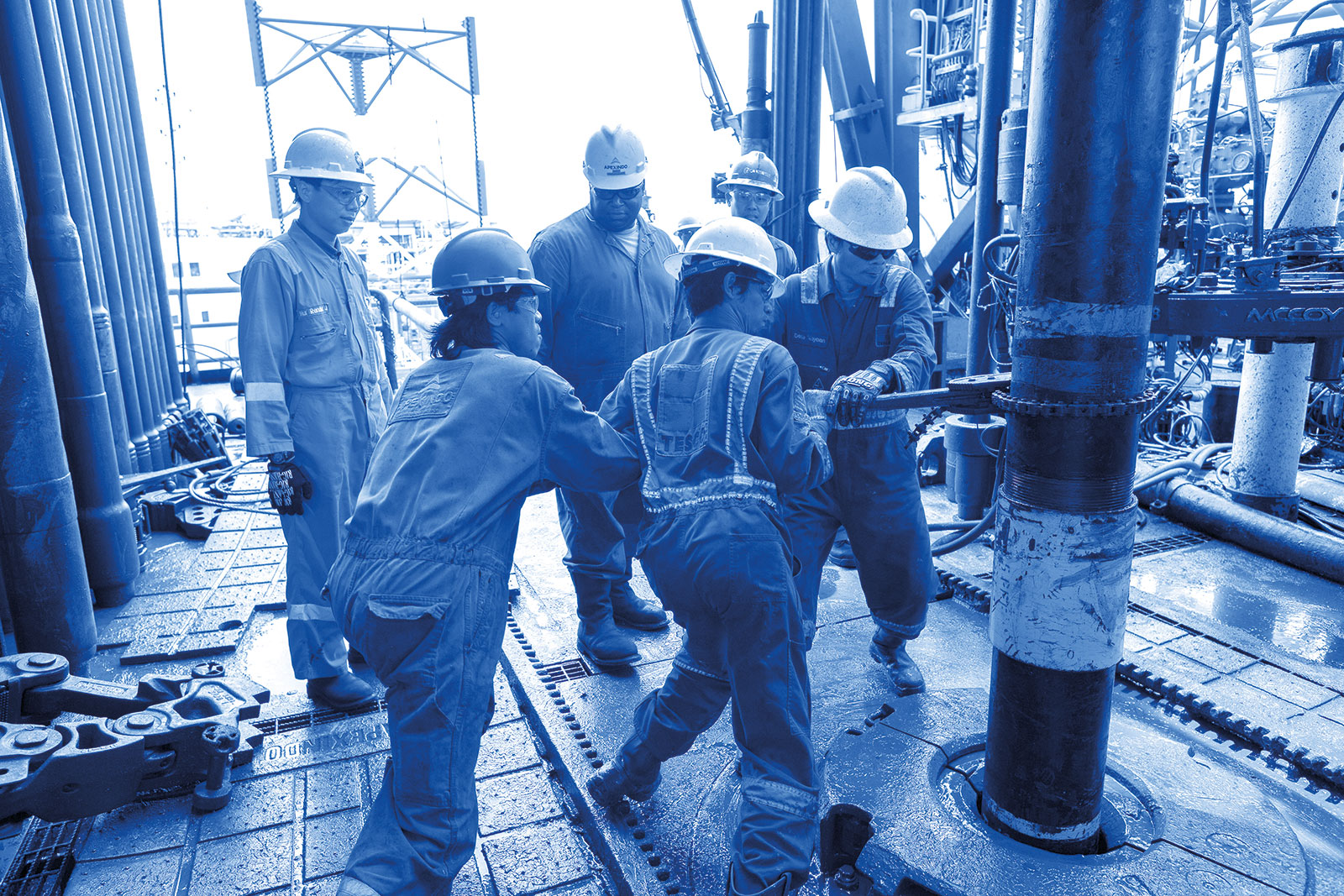 Drilling crew on a rig in Mahakam, Indonesia.