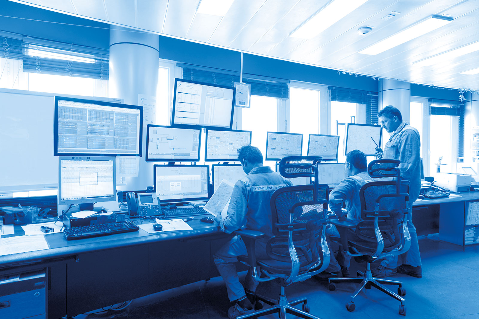Operators in a control room Al-Khalij oil terminal in Qatar.