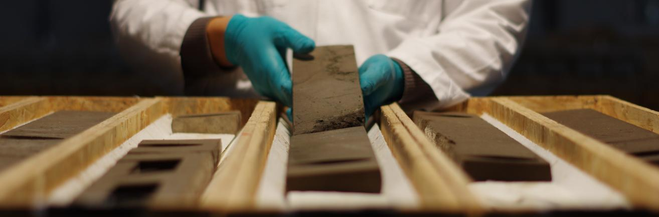 Man handling a core sample